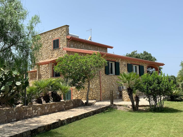 Villa with swimming pool in green park, by the sea