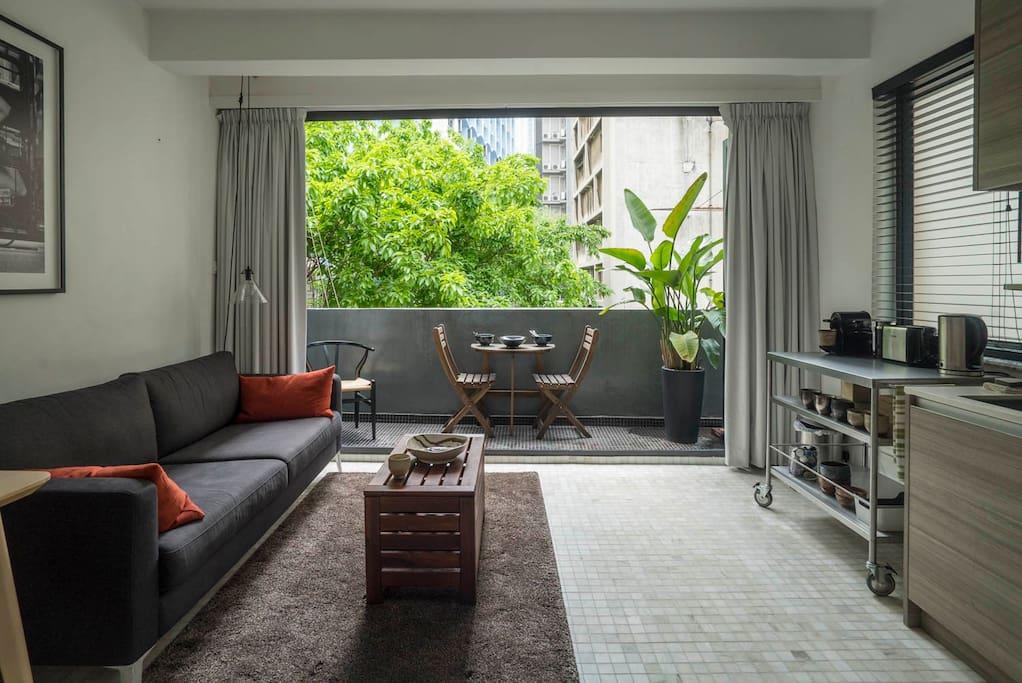 Sofa and folding doors to balcony