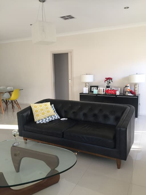 2 two seater sofas 42 in wall mounted tv great for movie watching or just a rest and a aperitif