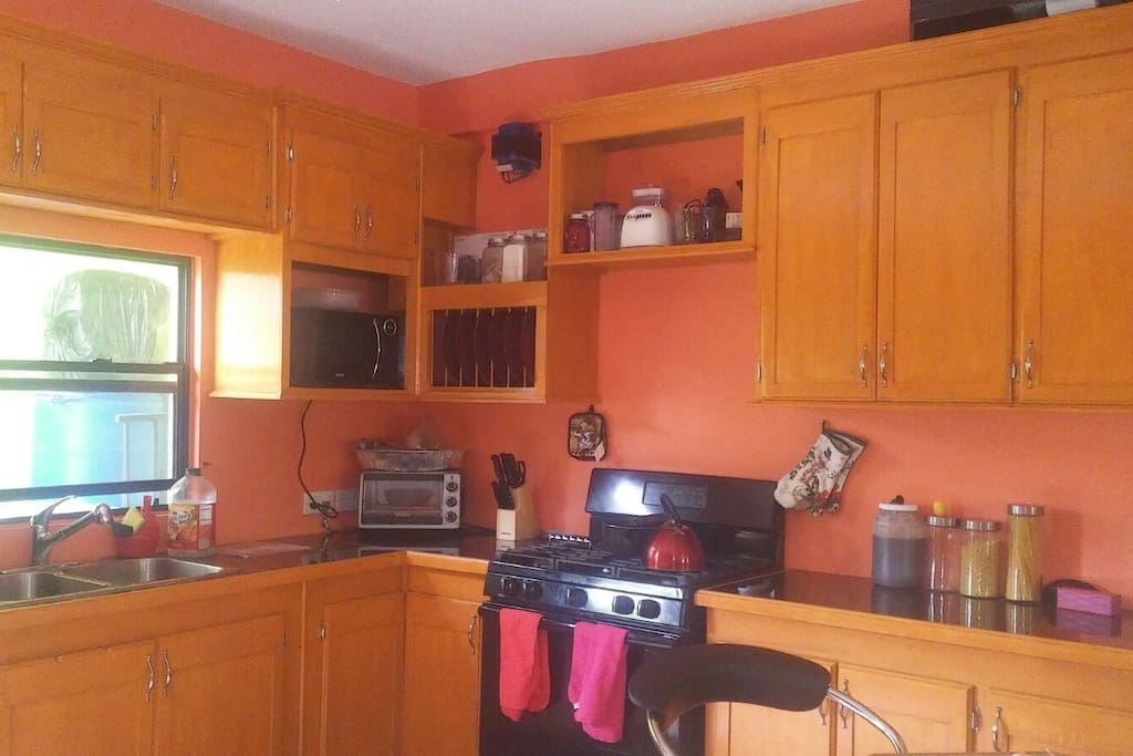 Our modern bright kitchen comes with gas stove (instructions for use provided), toaster oven, microwave & blender