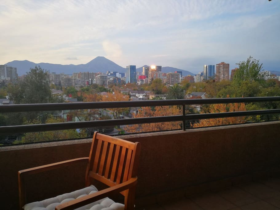 Balcony with a spectacular wide view over Santiago & the Andes