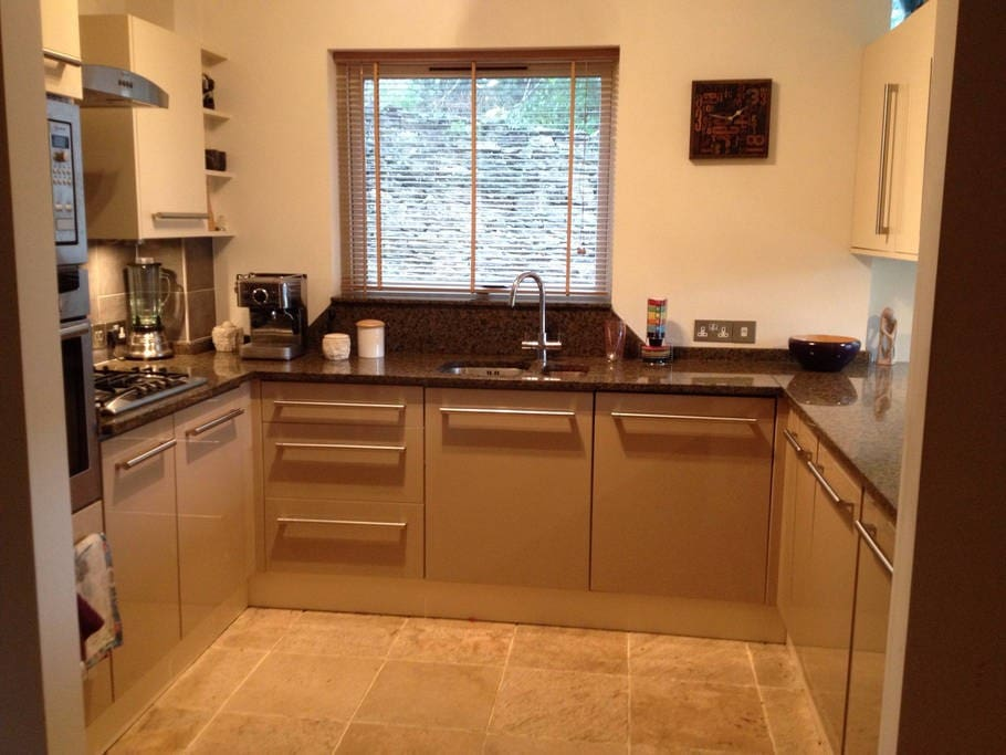 Kitchen: Gas cooking rings, electric oven, microwave, dishwasher, fridge, granite work tops, marble flooring with underfloor heating