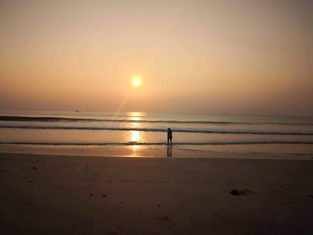 Enjoying the sunset in the beach