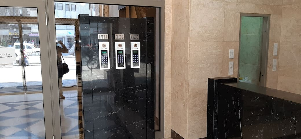 Building entrance password protected and on the right side is reception desk with 24/7 doorman