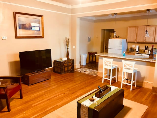 Open space from queen sofa to kitchen