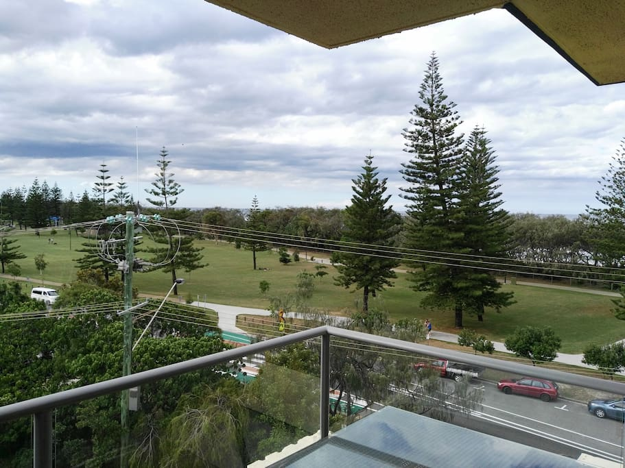 view from the unit across the street to the park beach