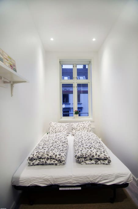The pull-out sofa bed when made up. You will be provided with clean towels and bed-sheets. Also a duvet and pillow.