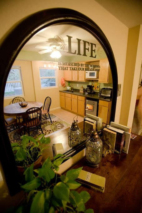 Cute kitchenette has coffeemaker, toaster oven, hot plate, refrige and micro.