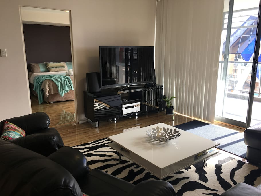 Large comfortable lounge with huge TV