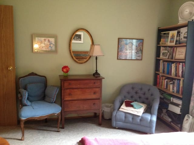 The bedroom has comfiest chair to sit, read & relax.