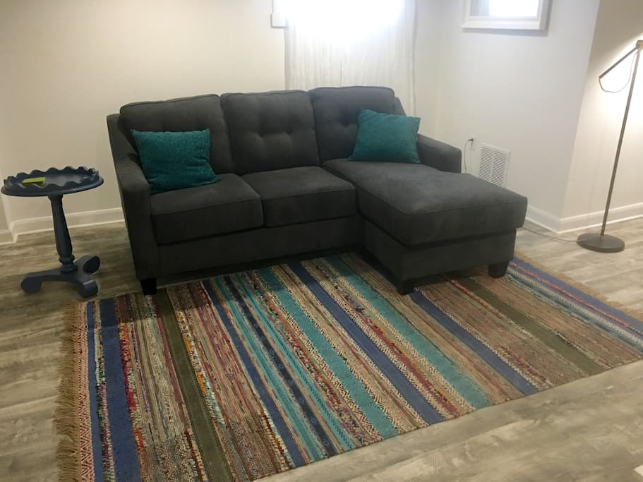 Lounge and relax on the comfortable couch which can be utilized as a sleeping area