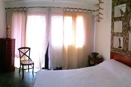 BEACHFRONT EXOTIC ROOM - San Jose - บ้าน
