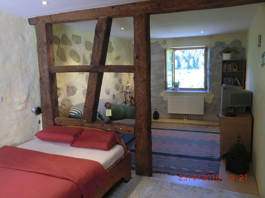 Historic flair with old wooden beams & natural stone walls