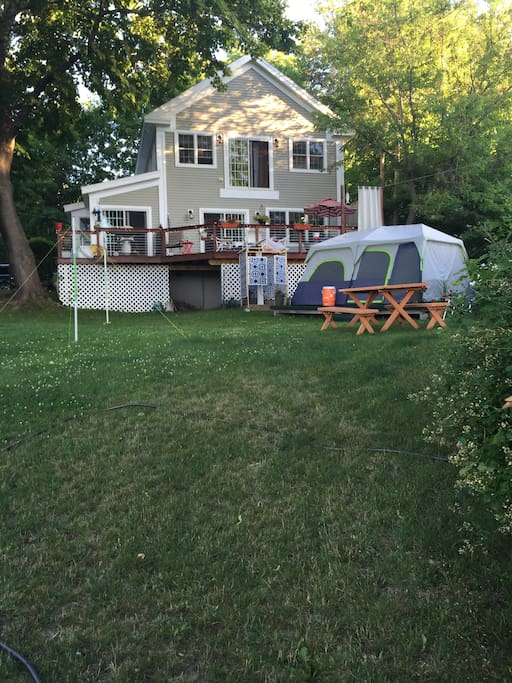 Summer from Water.  Home and outside 10 man Glamping Tent