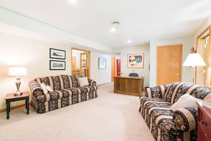 Living room with desk; looking toward bedroom, on left, kitchen down short hall ahead.