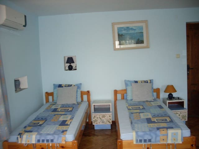 The Blue room . There are 2 separate  beds and one sofa bed. The room has balkony with amazing vew of sunrise and the garden.  Simple does not imply boring  but simply beautiful.