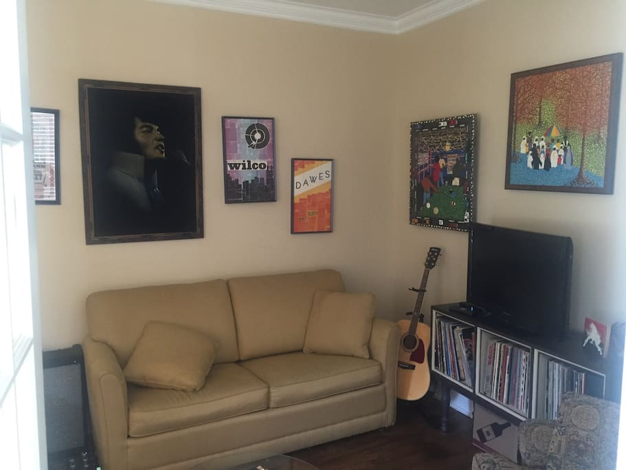 Guitar sitting room with pull out couch bed