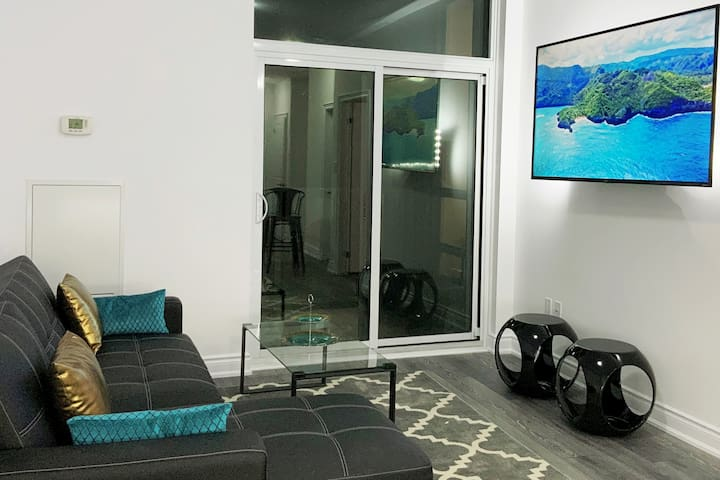 Family  room with Balcony, lake view & 65 Inch 4K UHD  Smart TV