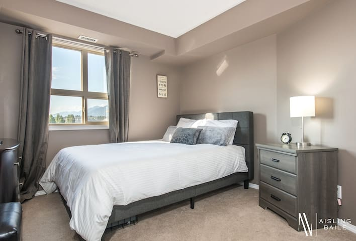 The second bedroom features a queen bed with premium hotel quality linens.
