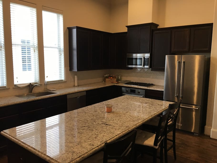 Huge kitchen with dining seating for 10 people.