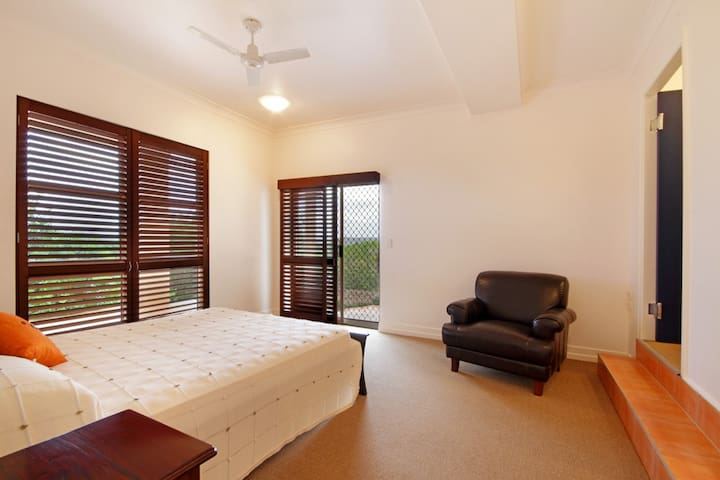 Light-filled double bedroom with en-suite robe