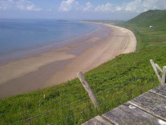 Rhossili Bay voted one of the top ten worldwide .Enjoy a walk around this beautiful area coastal path then have lunch in the worms head pub and enjoy the view