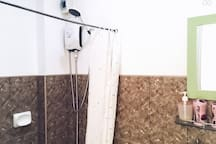 So fresh and clean! The shower provides you hot and cold water, whichever you prefer. Bathroom essentials are provided.