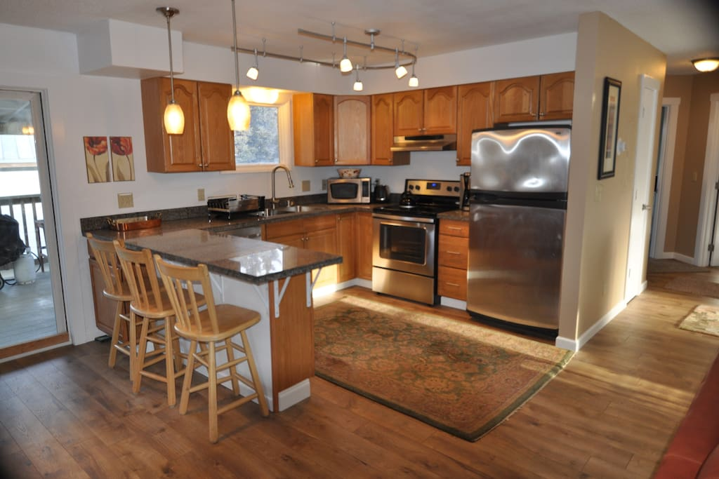 Open kitchen, stainless appliances, bar seating