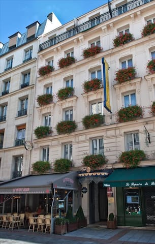 The charming facade overlooking Rue Cler not far from the Eiffel Tower district