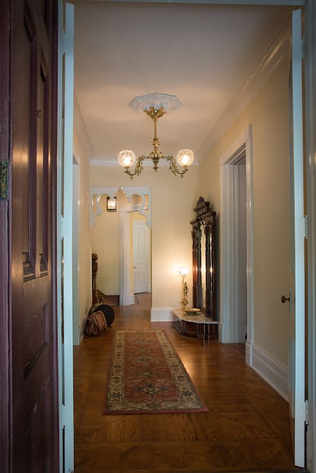 Foyer at the JL Mott Mansion with period gas light fixtures.