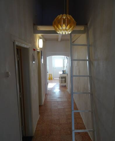 corridor to bed and bathroom