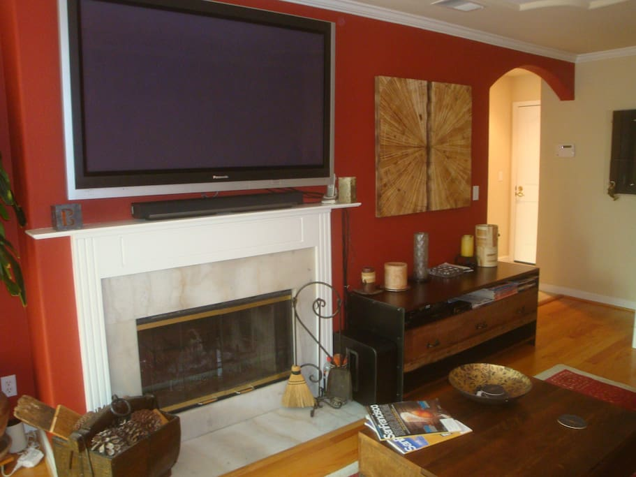 "A 60"" HDTV welcomes you to watch the pregame activities before you go to the big event."