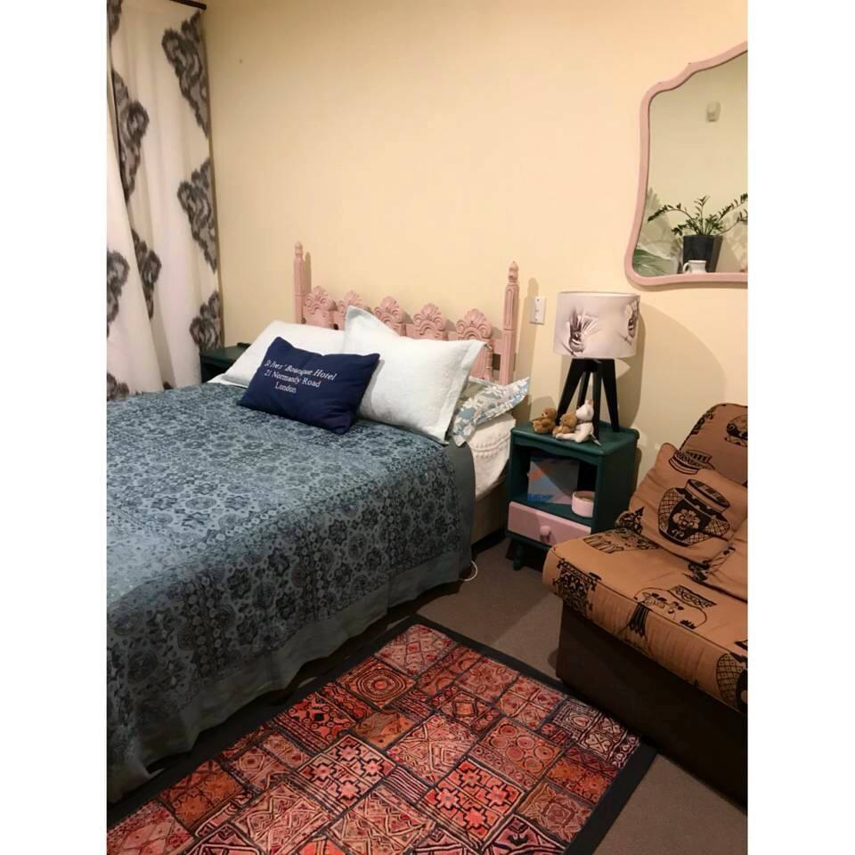 Bedroom for our guests with queen bed, desk and wardrobe