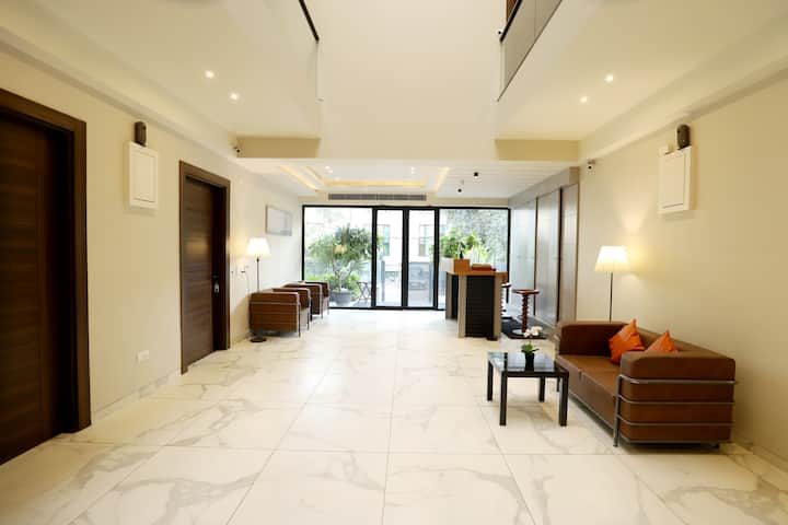 Retreat to a Stylish Room in Gurgaon.