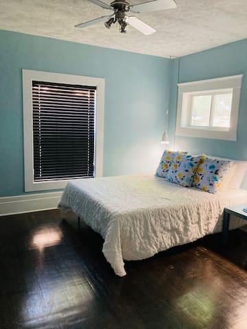Bedroom 2- queen bed Not shown- full desk and workspace.