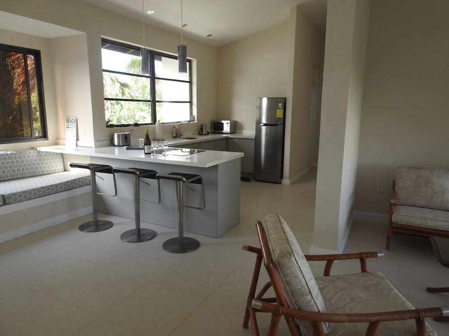 Open Plan Kitchen with bar, large window seat