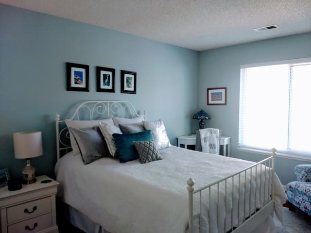 Guestroom. Dresser, desk, and comfy reading chair. Guests rave about the memory foam mattress.