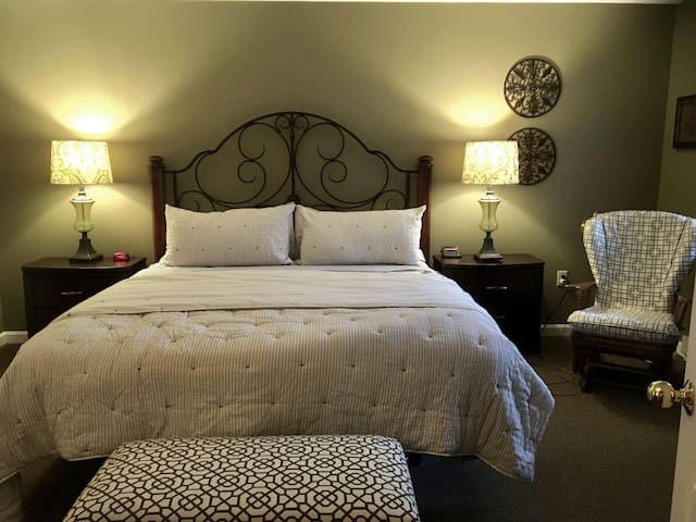 Newly remodeled master bedroom with king size bed and attached full bath