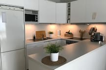 The kitchen has lots of counter space for preparing food or drinks.