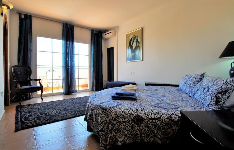 Master bedroom with panoramic seaviews.