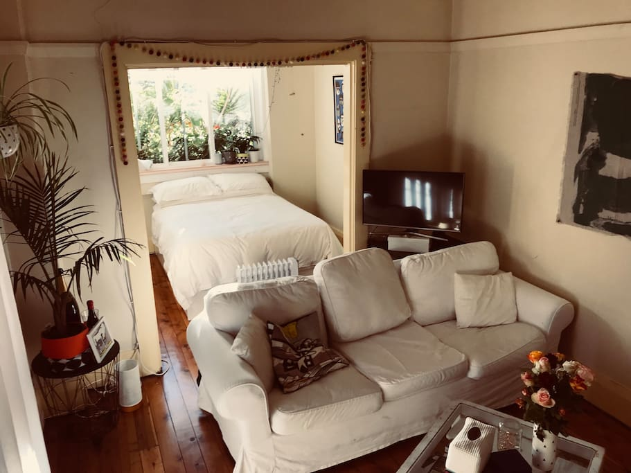 Lounge area, with 3 seat couch and TV