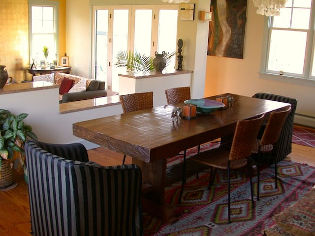 Dining looks over Living room. French doors to front deck. Comfortable seating for 6-8.