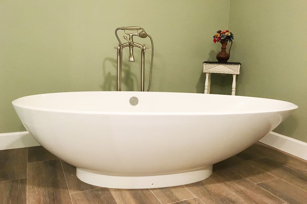 Luxurious tub in private bathroom. There is a huge spa shower in bathroom too!