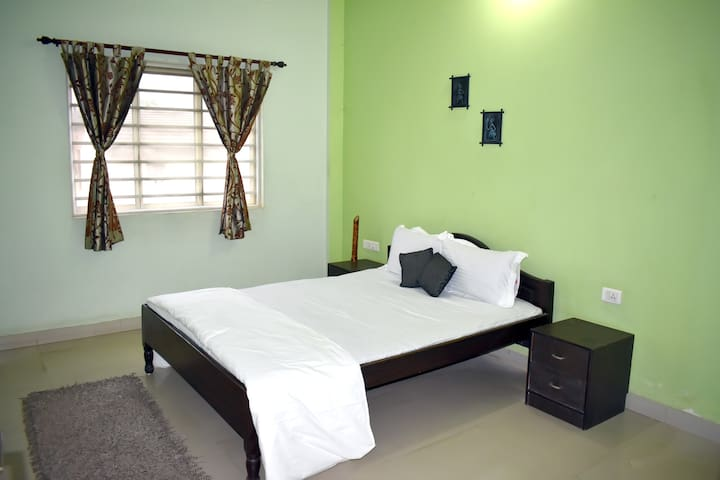 Beautiful non AC room with Queen bed and extra double mattress.