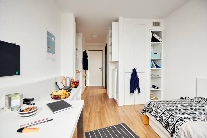 A long corridor leads through the apartment.