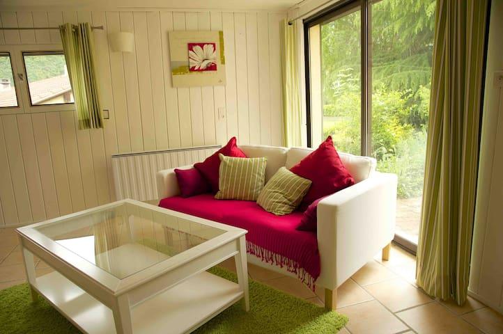 Master bedroom quiet sitting area with patio doors to the garden
