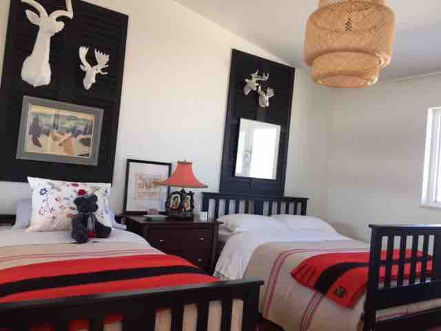 Double and single beds in upstairs bedroom
