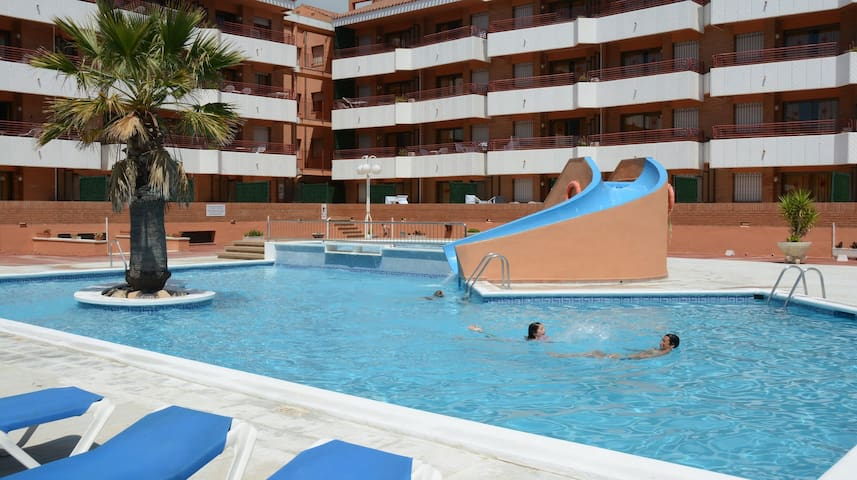Upper Floor Apartment with Balcony + Wi-Fi | Outdoor Pool!