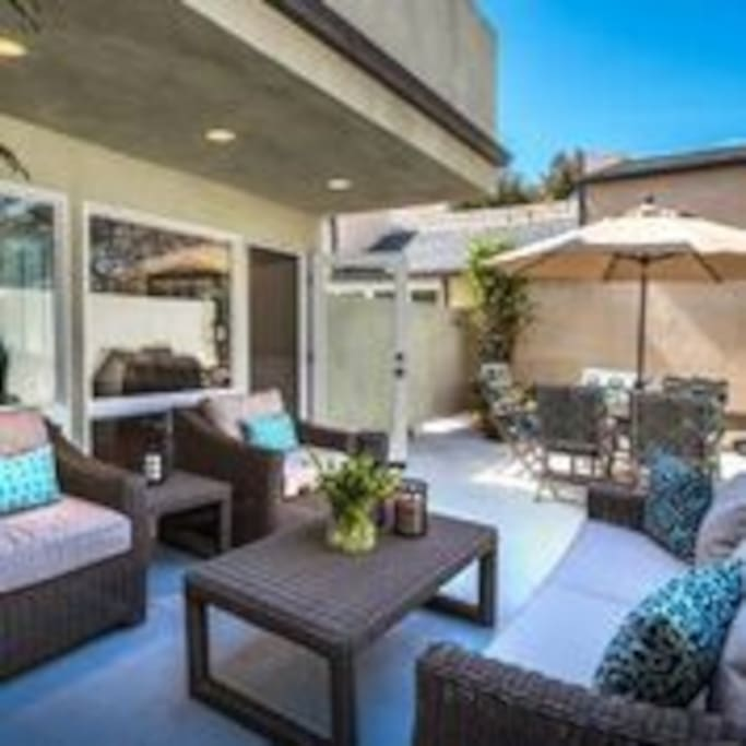 Large outdoor private patio with a BBQ and Table seating for 6