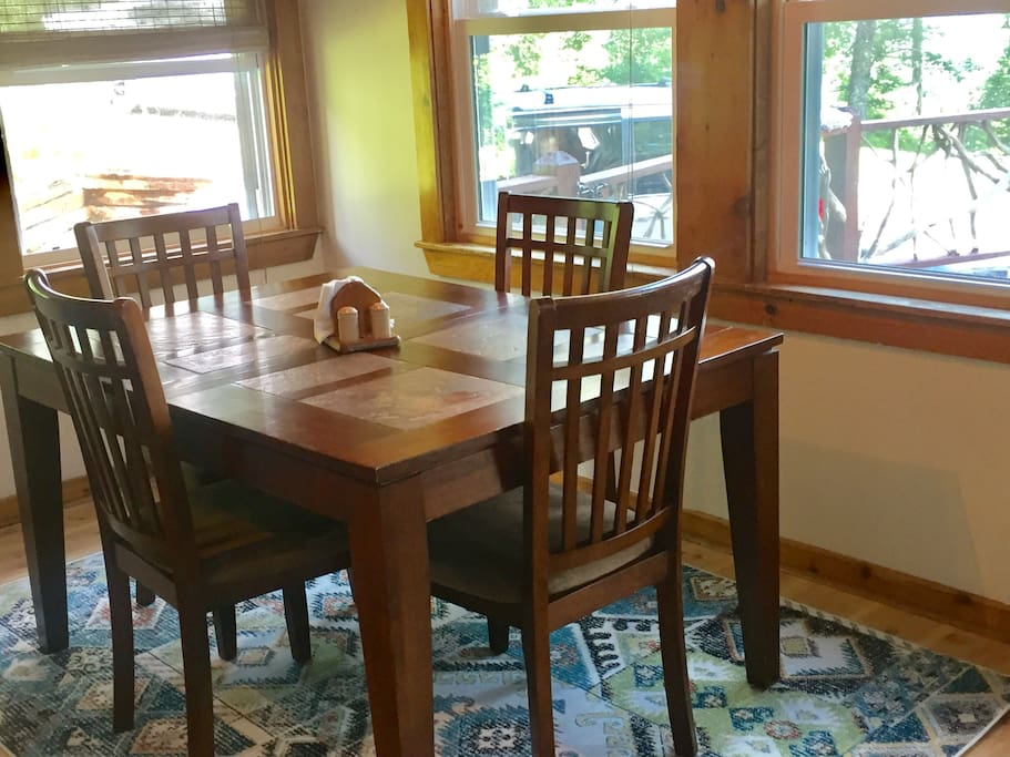 Dining nook. Table has built in leaf for more seating. Lots of light and beautiful views.